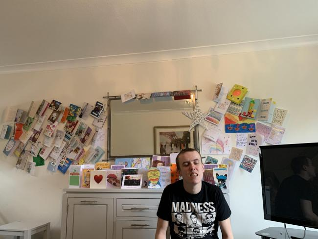 Boy with birthday cards