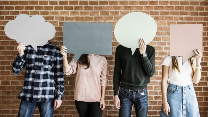 People standing with speech bubbles over their faces